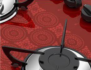 Detalhe de cooktop 2 bocas com estampa crochê, uma delicada num equipamento luxuoso