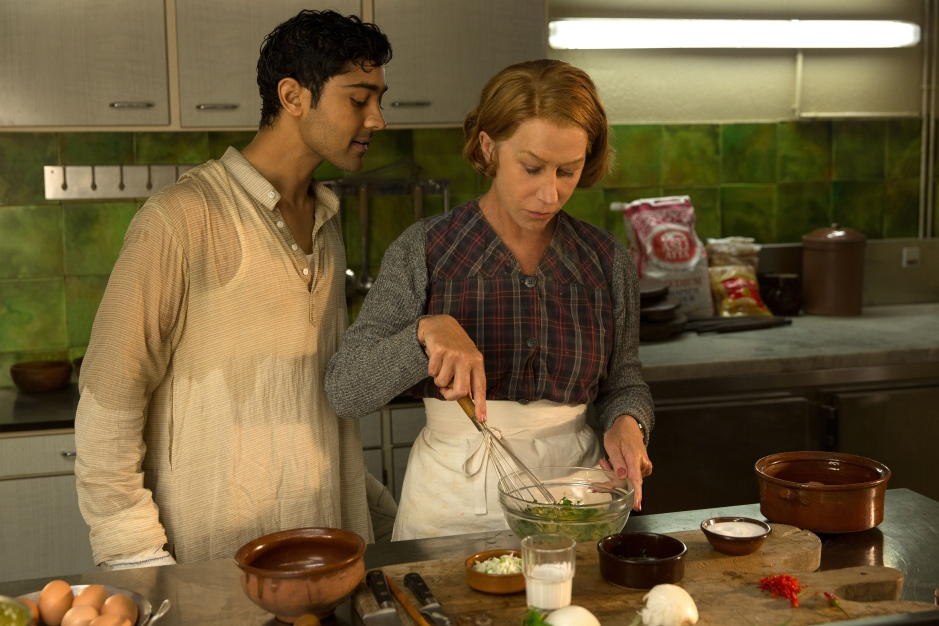HFJ-0068r ..When Hassan Kadam (Manish Dayal) and his family move from India to a village in the South of France, they open a restaurant and encounter Madame Mallory, (Academy Award?-winner Helen Mirren) the chef proprietress of a classical Michelin-starred French restaurant across the street. Cultures collide, but they eventually find common ground through their love of cooking, in DreamWorks Pictures? charming film, ?The Hundred-Foot Journey.? Based on the novel ?The Hundred-Foot Journey? by Richard C. Morais, the film is directed by Lasse Hallstr?m. The producers are Steven Spielberg, Oprah Winfrey and Juliet Blake. Photo: Fran?ois Duhamel ..?2014 DreamWorks II Distribution Co., LLC. All Rights Reserved.